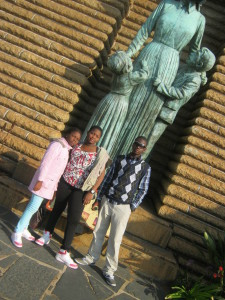 Nieces and Nephew  infront of the Statue of a Voortrekker Woman